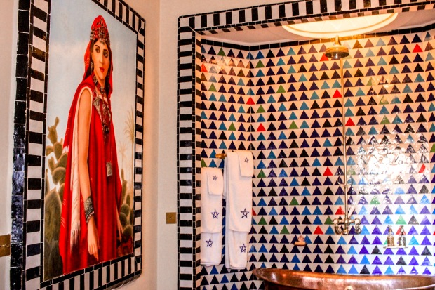 Murals have a place in the bathroom too and add some tiles round the edge to look like a frame. http://salutmaroc.com