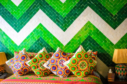 Love the different shades between wall & fabrics that again shouldn't work but do! http://salutmaroc.com