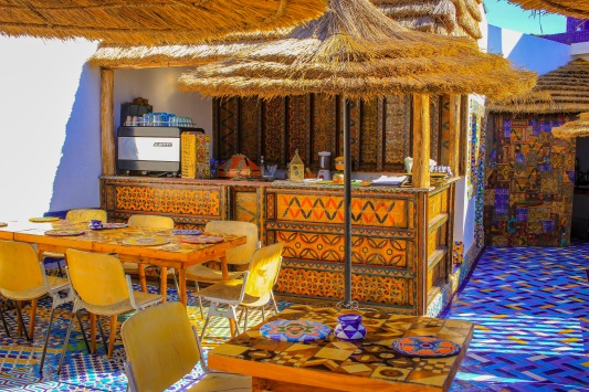 Love the colourful floor tiles on the roof top and patterned table tops. http://salutmaroc.com